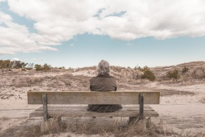 Older woman sitting on bench