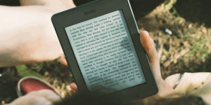 Person reading from Kindle