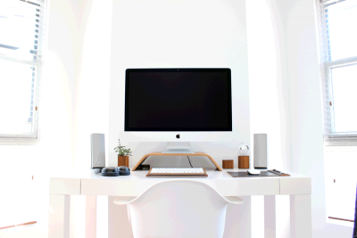 A desktop with computer devices.